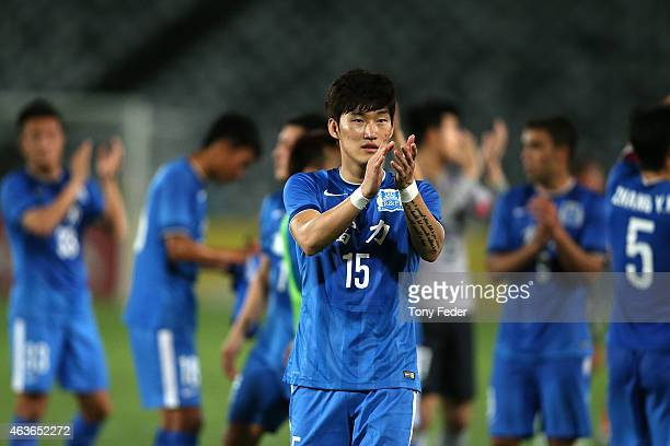 Jang Hyunsoo of Guangzhou RF applauds the crowd after defeating the Mariners during the Asian Champions League qualifying match between the Central...