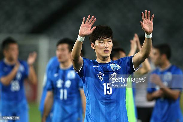 Jang Hyunsoo of Guangzhou RF waves to the crowd after defeating the Mariners during the Asian Champions League qualifying match between the Central...