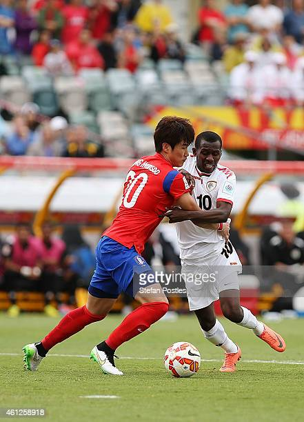 Jang Hyunsoo of Korea Republic and Qasim Said of Oman contests possession during the 2015 Asian Cup match between Korea Republic and Oman at Canberra...