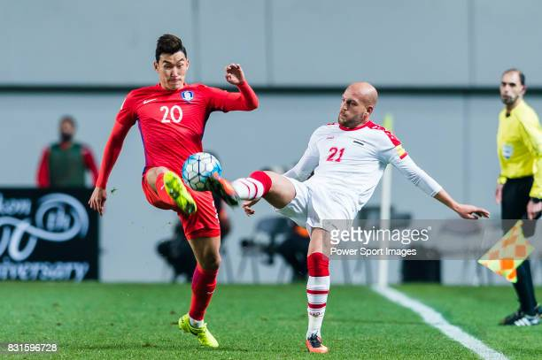 Jang Hyunsoo of Korea Republic battles for the ball with Nasouh Nakdali of Syria during their 2018 FIFA World Cup Russia Final Qualification Round...
