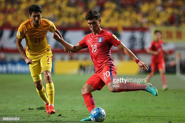 Jang Hyunsoo of South Korea and Yu Hai of China vie for the ball during the 2018 FIFA World Cup Qualifier Final Round Group A match between South...