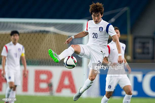 Jang Hyunsoo of South Korea follows the ball in group match between Japan and South Korea during EAFF East Asian Cup 2015 at Wuhan Sports Center...