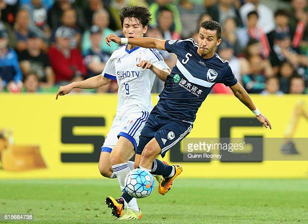 Jang Hyunsoo of Suwon and Daniel Georgievski of the Victory compete for the ball during the AFC Champions League match between the Melbourne Victory...