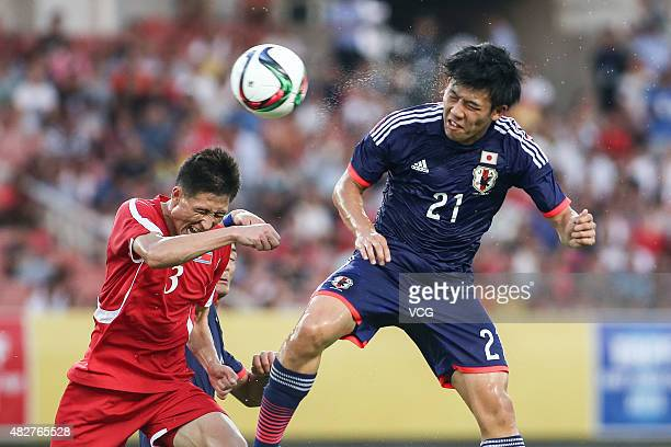 Jang KukChol of DPR Korea and Wataru Endo of Japan compete for the ball during the EAFF East Asian Cup 2015 football match between DPR Korea and...