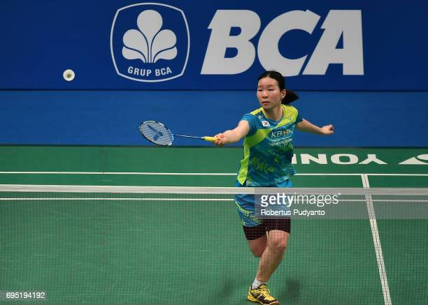 Jang Mi Lee of Korea competes against Lyanny Alessandra Mainaky of Indonesia during Womens single qualification round match of the BCA Indonesia Open...