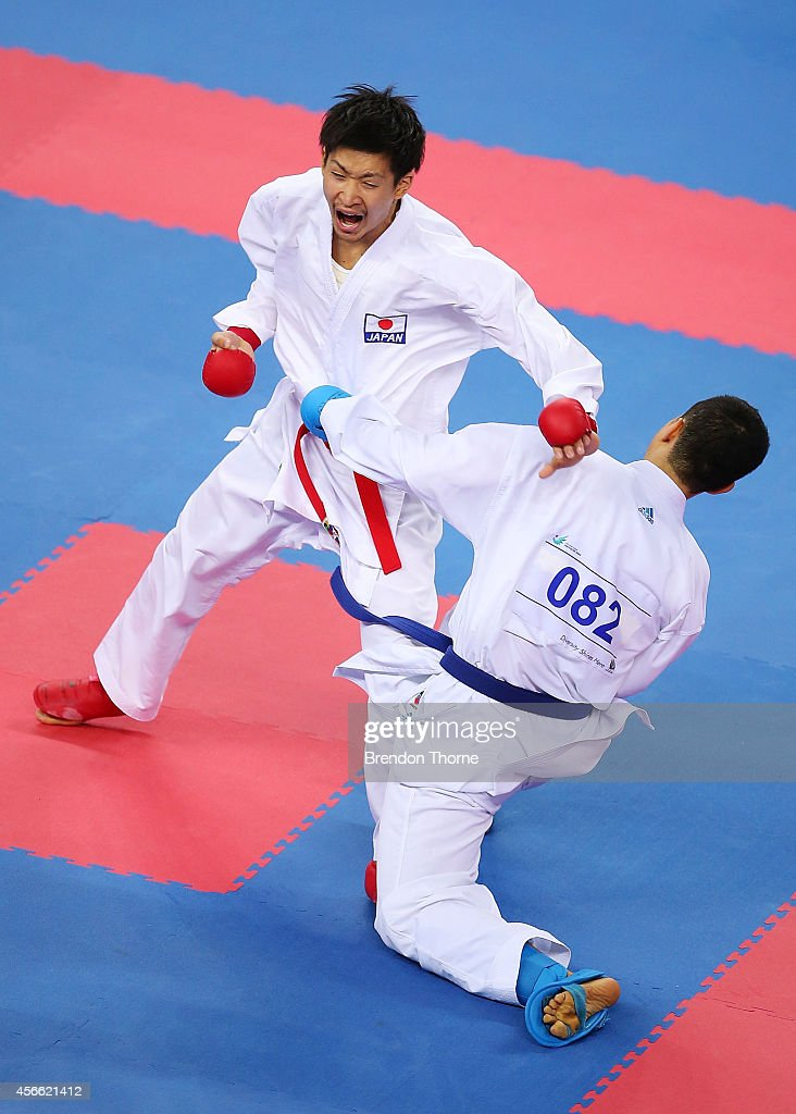Jang Minsoo of South Korea competes against <a gi-track='captionPersonalityLinkClicked' href=/galleries/search?phrase=Ryutaro+Araga&family=editorial&specificpeople=7361550 ng-click='$event.stopPropagation()'>Ryutaro Araga</a> of Japan in the Men's -84kg Quater Final match during day fifteen of the 2014 Asian Games at Gyeyang Gymnasium on October 4, 2014 in Incheon, South Korea.