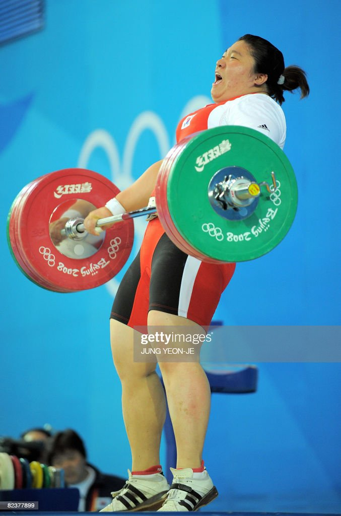 Jang Miran of South Korea sets a new world record in the snatch, lifting 140 kg in the women's +75 kg weightlifting event during the 2008 Beijing Olympic Games on August 16, 2008.