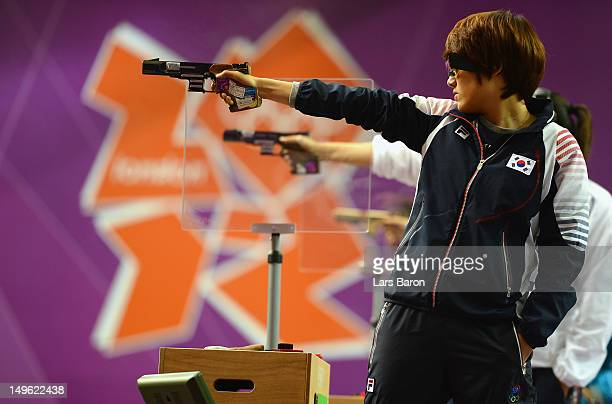 Jangmi Kim of Korea competes in the Women's 25m Pistol Shooting final on Day 5 of the London 2012 Olympic Games at The Royal Artillery Barracks on...