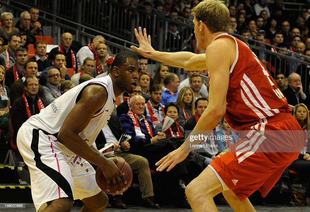 Jan-Hendrik Jagla (R) of Muenchen blocks Patrick Ewing Jr. of Bonn during the Beko Basketball match between FC Bayern Muenchen and Telekom Baskets Bonn at Audi-Dome on December 9, 2012 in Munich, Germany.