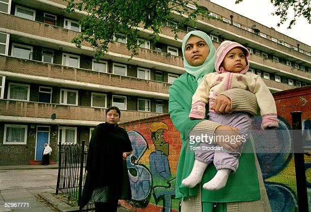 Janhura Begum with her 8 month old baby girl Nazha Begum outside the family home on the BromleybyBow estate in the multicultural Bethnal Green area...