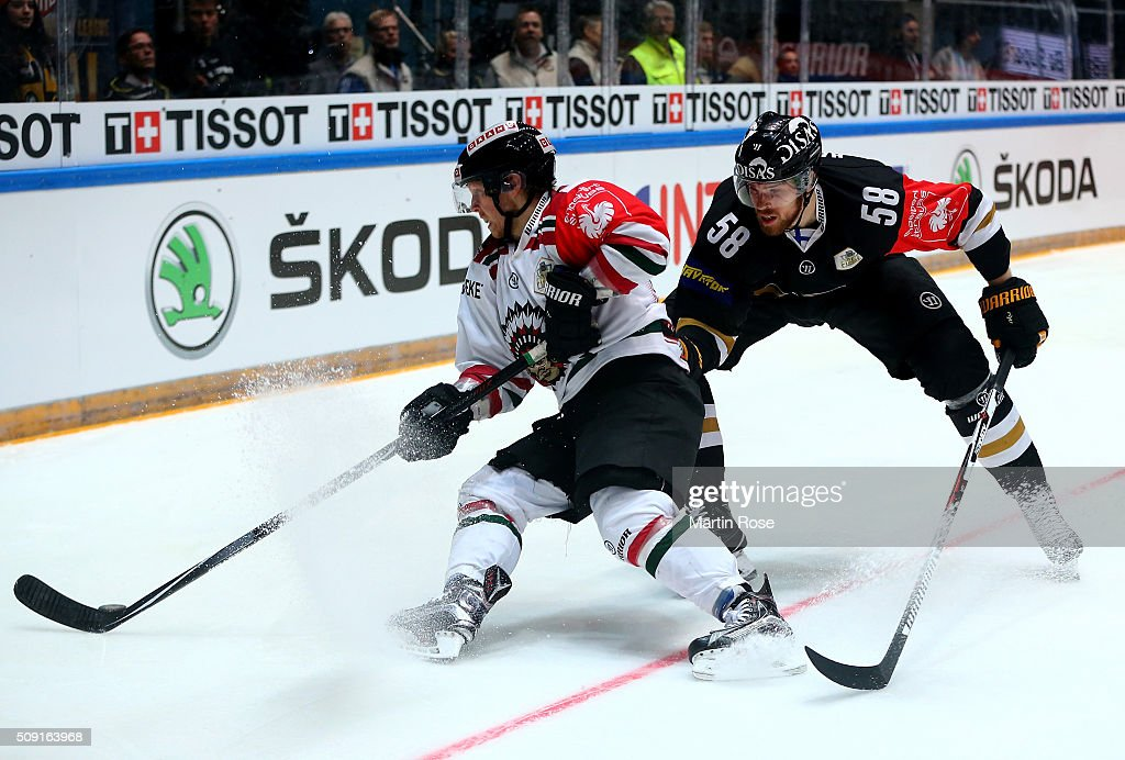 Jani Hakanpaa #58 of Oulu and Anton Axelsson of Gothenburg battle for the puck during the Champions Hockey League final game between Karpat Oulu and Frolunda Gothenburg at Oulun Energia-Areena on February 9, 2016 in Oulu, Finland.