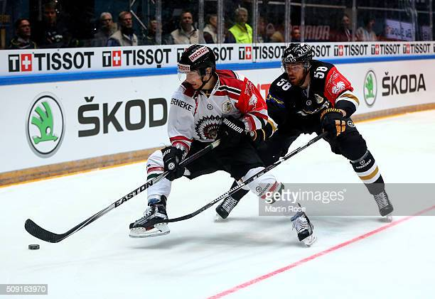 Jani Hakanpaa of Oulu and Anton Axelsson of Gothenburg battle for the puck during the Champions Hockey League final game between Karpat Oulu and...