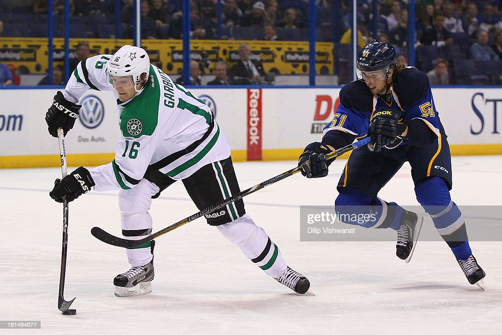 Jani Hakanpaa #51 of the St. Louis Blues defends against Ryan Garbutt #16 of the Dallas Stars during a preseason at the Scottrade Center on September 21, 2013 in St. Louis, Missouri.