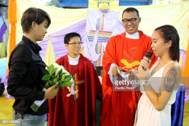 Janica Karla P Nazario 24 years old and Sandie E Caluag 20 years old and ten months in relationship during their wedding ceremony on the Grand Mass...