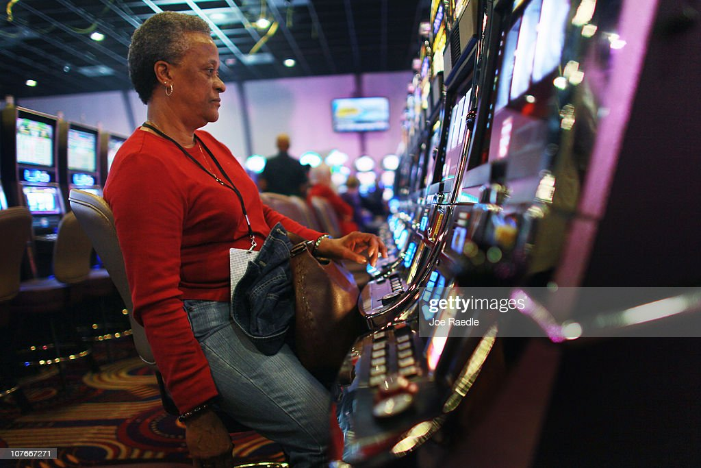 Janice Brown plays a slot machine during the grand opening of the newest building at the Seminole Casino Coconut Creek on December 17, 2010 in Coconut Creek, Florida. The site offers up an additional 400-plus gaming positions, a new restaurant and a new venue with more space to gamble, dine and party.