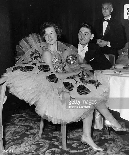 Janice Dumbleton wearing an evening dress made of sequins and net seen at a party held in the Grosvenor House Hotel London