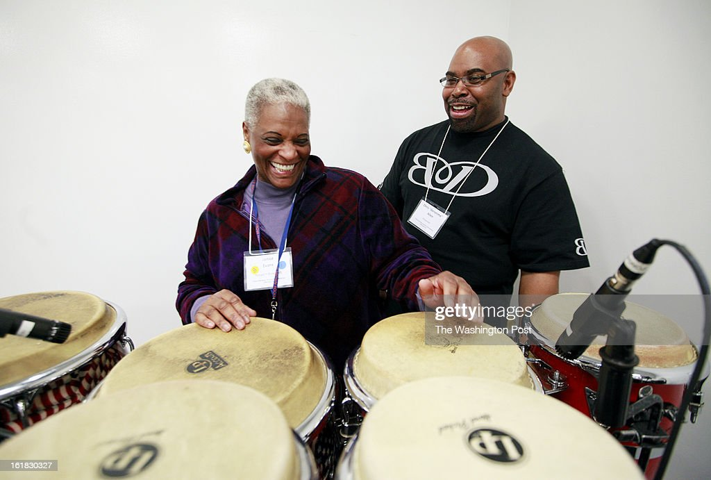 Janice Evans, an instrumental music teacher at Ronald H. Brown Middle School, gives the drums a try under the direction of Chris 'Geronimo' Allen during in a workshop on go-go music at the DC Commission on the Arts and Humanities on Saturday, February 16, 2013. Allen has played with many bands and musicians, such as Trouble Funk, Chuck Brown, Outkast and Earth, Wind and Fire.