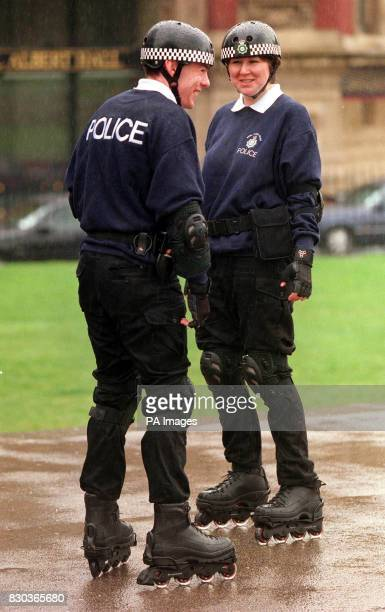 WPC Janice Jarvis and PC Ken Hynd from the Royal Parks Constabulary wearing rollerblades in Kensington Palace Gardens as part of its community...