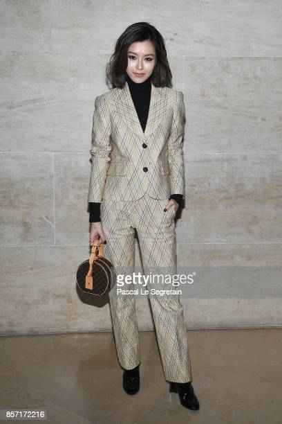 Janice Man attends the Louis Vuitton show as part of the Paris Fashion Week Womenswear Spring/Summer 2018 on October 3 2017 in Paris France