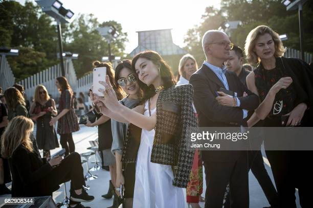 Janice Man center takes a selfie before attending the Louis Vuitton Resort 2018 show at the Miho Museum on May 14 2017 in Koka Japan