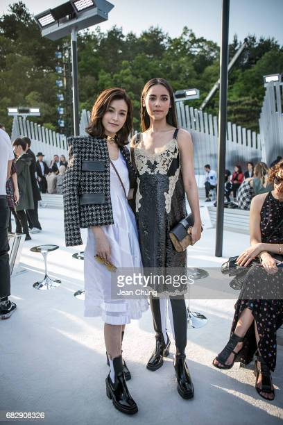 Janice Man left and Yaya attend the Louis Vuitton Resort 2018 show at the Miho Museum on May 14 2017 in Koka Japan