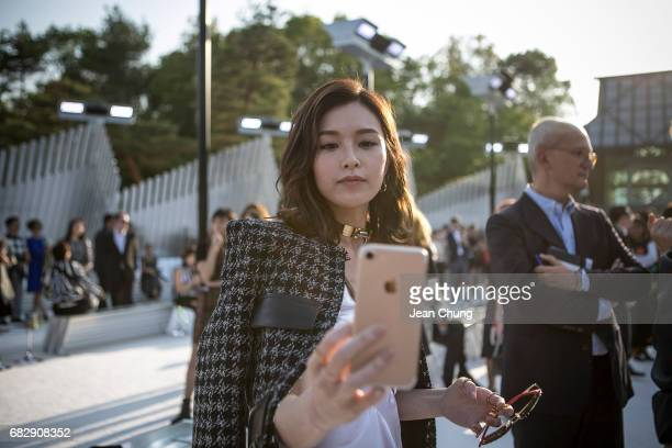 Janice Man takes a selfie before attending the Louis Vuitton Resort 2018 show at the Miho Museum on May 14 2017 in Koka Japan