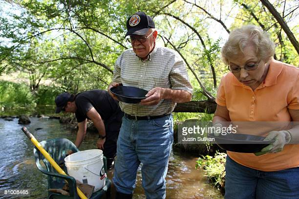 Janice Ross and her husband Patrick Ross of Bellvue Florida pan for gold at Gold Prospecting Adventures May 6 2008 in Jamestown California With gold...