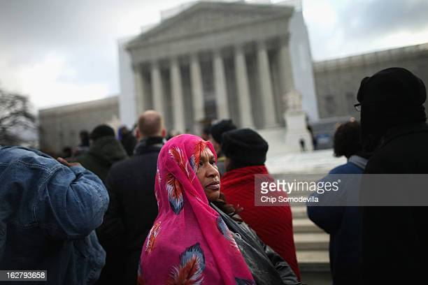Janice Winborn of Deatsville Alabama waits in line with other residents from Alabama to attend oral arguments at the US Supreme Court February 27...