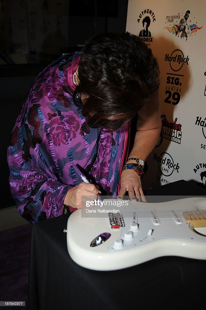 Janie Hendrix autographs a Fender guitar at Jimi Hendrix 70th birthday party at Hard Rock Cafe Seattle on November 27, 2012 in Seattle, Washington.