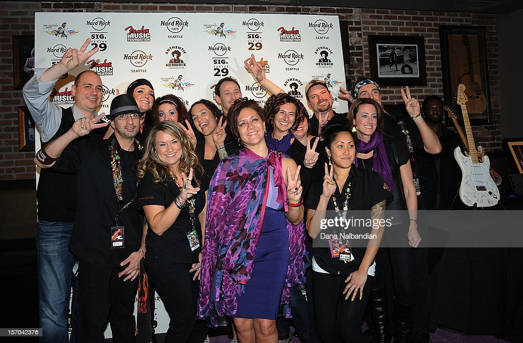 Janie Hendrix (c) with guests at Jimi Hendrix 70th birthday party at Hard Rock Cafe Seattle on November 27, 2012 in Seattle, Washington.