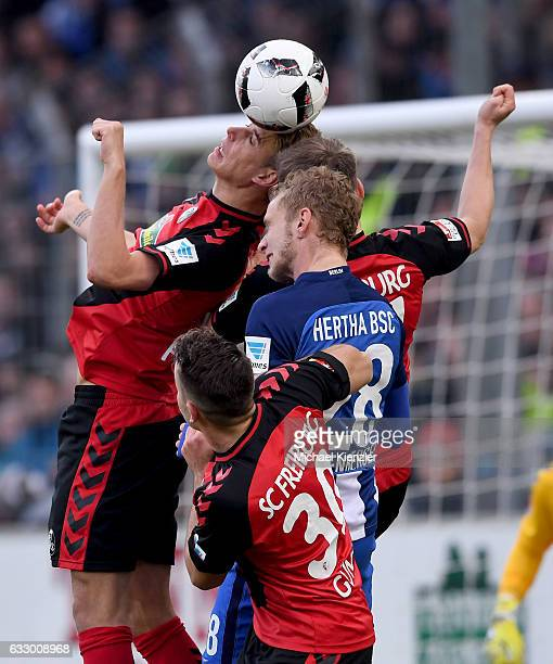 Janik Haberer Lukas Kuebler of SC Freiburg Fabian Lustenberger of Hertha BSC and Christian Guenter of SC Freiburg fighting for the ball during the...