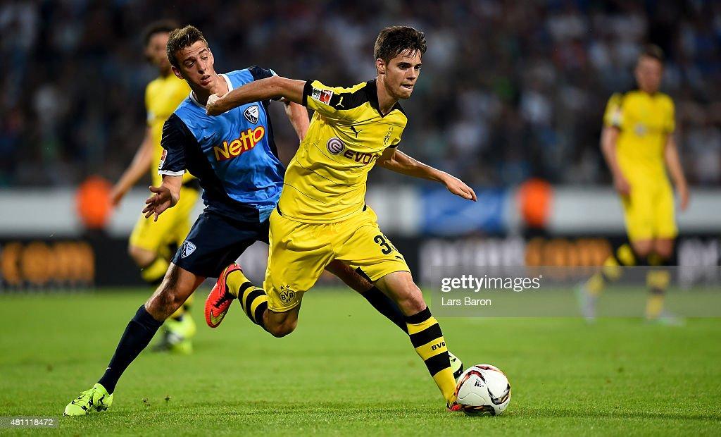 Janik Haberer of Bochum challenges Julian Weigl of Dortmund during a preseason friendly match between VfL Bochum and Borussia Dortmund at Rewirpower...
