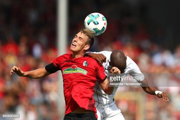 Janik Haberer of FC Freiburg and Gelson Fernandes of Frankfurt during the Bundesliga match between SportClub Freiburg and Eintracht Frankfurt at...