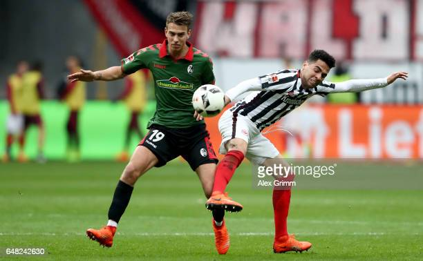 Janik Haberer of Freiburg challenges Omar Mascarell of Frankfurt during the Bundesliga match between Eintracht Frankfurt and SC Freiburg at...