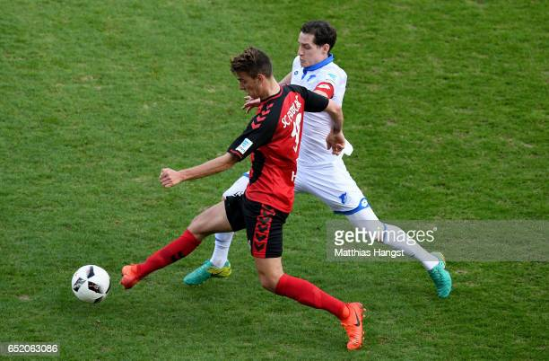 Janik Haberer of Freiburg challenges Sebastian Rudy of Hoffenheim during the Bundesliga match between SC Freiburg and TSG 1899 Hoffenheim at...