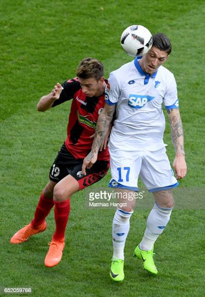 Janik Haberer of Freiburg challenges Steven Zuber of Hoffenheim during the Bundesliga match between SC Freiburg and TSG 1899 Hoffenheim at...