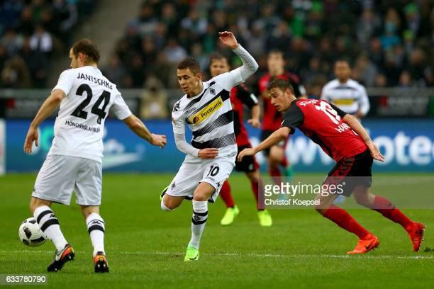 Janik Haberer of Freiburg challenges Thorgan Hazard of Moenchengladbach during the Bundesliga match between Borussia Moenchengladbach and SC Freiburg...