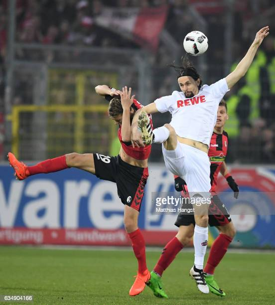 Janik Haberer of Freiburg goes up for a header with Neven Subotic of Koeln during the Bundesliga match between SC Freiburg and 1 FC Koeln at...