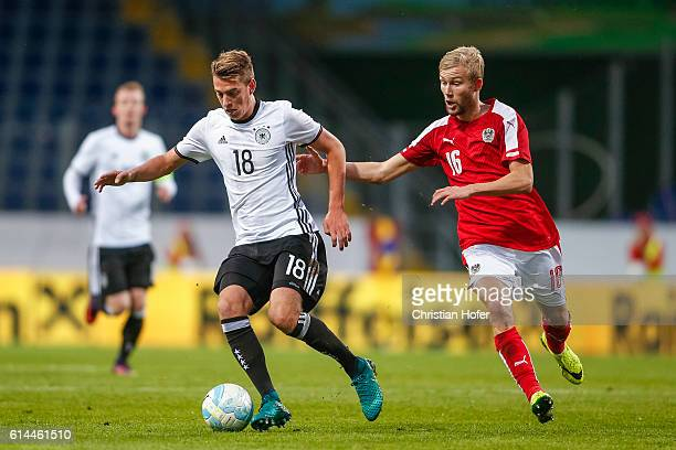 Janik Haberer of Germany challenges Konrad Laimer of Austria for the ball during the 2017 UEFA European U21 Championships Qualifier between U21...