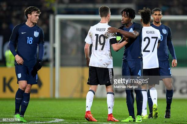 Janik Haberer of Germany shakes hands with Nathaniel Chalobah of England after the U21 international friendly match between Germany and England at...