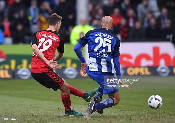 Janik Haberer of SC Freiburg shoots the opening goal against John Anthony Brooks of Hertha during the Bundesliga match between Sport Club Freiburg...