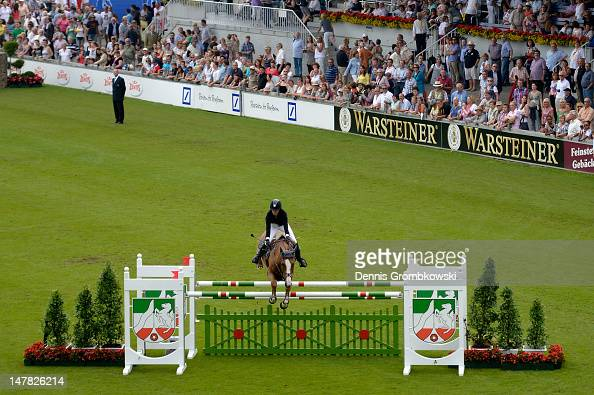 Janika Sprunger of Suisse and Palloubet D Halong compete in the Warsteiner Price of Europe S4 jumping competition during day two of the 2012 CHIO...