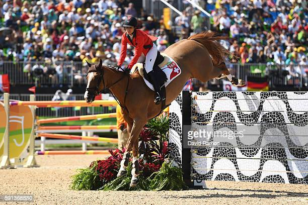 Janika Sprunger of Switzerland rides Bonne Chance CW during the Jumping Team Round 2 during Day 12 of the Rio 2016 Olympic Games at the Olympic...