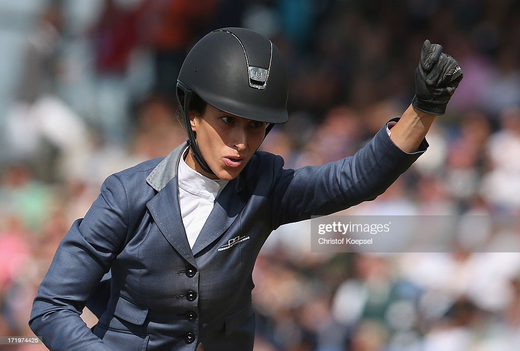 Janika Sprunger of Switzerland rides on Palloubet d'Halong and won the second place during the Rolex Grand Prix jumping competition during the 2013 CHIO Aachen tournament on June 30, 2013 in Aachen, Germany.