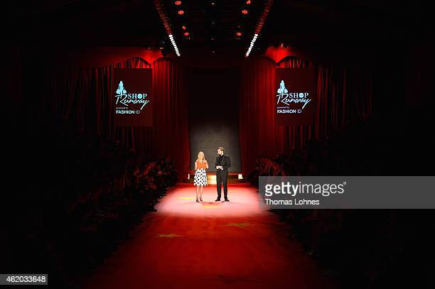 Janin Reinhardt and Steven Gaetjen stand on the runway at the 'Shop the Runway by FASHION ID' show during the MercedesBenz Fashion Week Berlin...