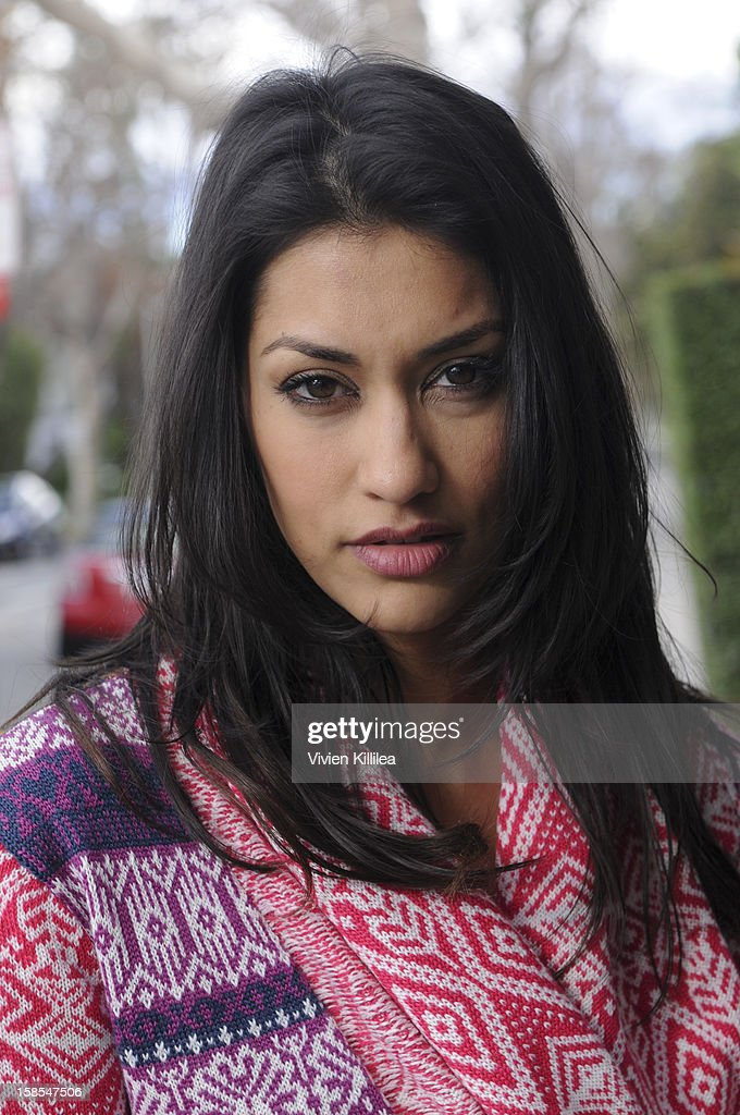 Janina Gavankar poses for a photo session on December 18, 2012 in Los Angeles, California.