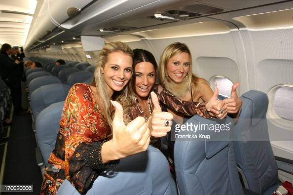 Janina Martig Mariella Ahrens And Yvonne Hölzel Posing In The Airbus 'Fly Into The Sunshine' Air Berlin Medientreff in Hangar 2 In Event Center...
