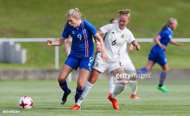 Janina Minge of Germany battles for the ball with Asdis Halldorsdottir of Iceland during the U19 women's elite round match between Germany and...