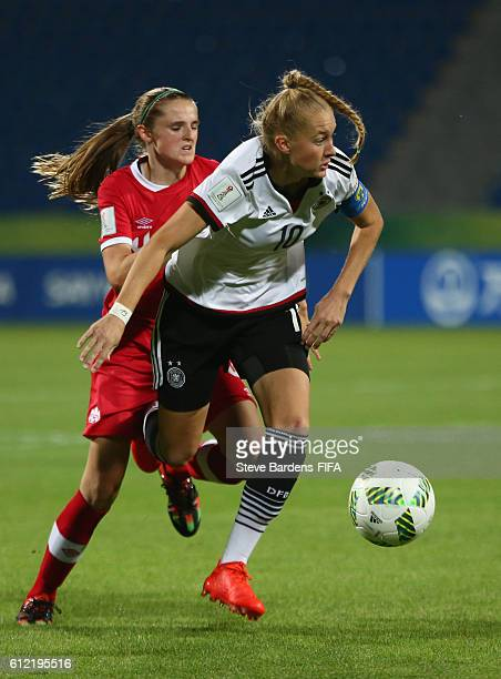 Janina Minge of Germany breaks away from the Canada defence during the FIFA U17 Women's World Cup Jordan 2016 Group B match between Germany and...