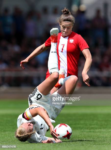 Janina Minge of Germany is attacked by Klaudia Lefeld of Poland during the U19 women's elite round match between Poland and Germany at Stadion...
